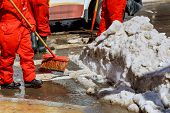 Workers Sweep Snow From Road In Winter. Cleaning Road From Snow Storm poster