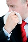 picture of rhinitis  - Ill Businessman with tissue suffering from Rhinitis or Allergy - JPG