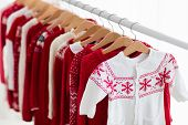 Clothes Rack With Red Christmas Knit Wear poster