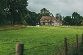 Country House With Green Garden And Lawn In The Region Of Normandy, France. Beautiful Countryside, F poster
