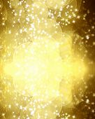 stock photo of gold glitter  - gold glitter on a dark yellow background - JPG