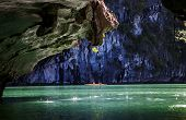 kayaking among caves and lagoon in Ha Long bay, UNESCO world heritage site, Vietnam poster