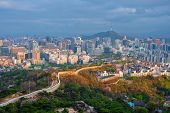 Aerial view of Seoul downtown cityscape and Namsan Seoul Tower on sunset from Inwang mountain. Seoul poster