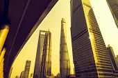 In the picture is jin mao tower,shanghai tower,shanghai world financial center,shanghai,china. poster