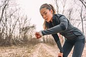 Sport watch run woman checking smartwatch tracker. Trail running runner girl looking at heart rate m poster