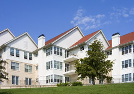 stock photo of high-rise  - Luxury Brick Condos on the hill overlooking Lake Michigan - JPG