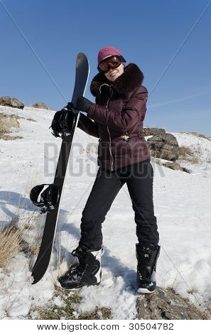 The Smiling Young Woman  With A Snowboard