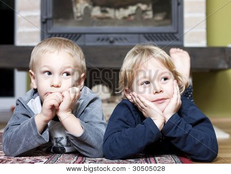Siblings on floor looking at something