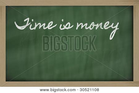 Expression -  Time Is Money - Written On A School Blackboard With Chalk