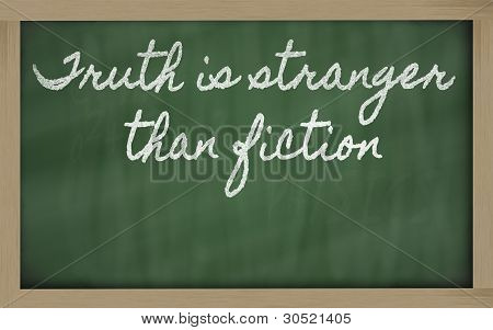 Expression -  Truth Is Stranger Than Fiction - Written On A School Blackboard With Chalk