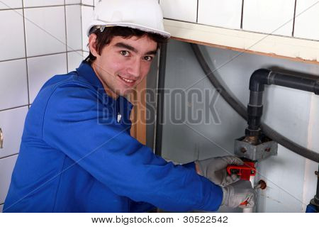 junior plumber at work