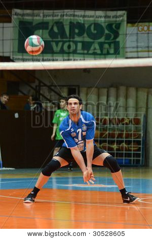 KAPOSVAR, HUNGARY - FEBRUARY 27: Andras Geiger in action at a Hungarian volleyball National Championship game Kaposvar (blue) vs. Csepel ( deep blue), on February 27, 2012 in Kaposvar, Hungary.
