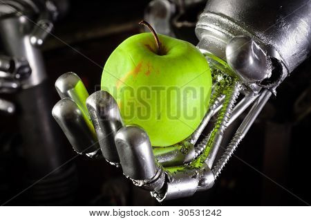 A Robot Hand Holding A Fresh Apple