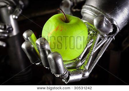 A Robot Hand Holding A Fresh Apple