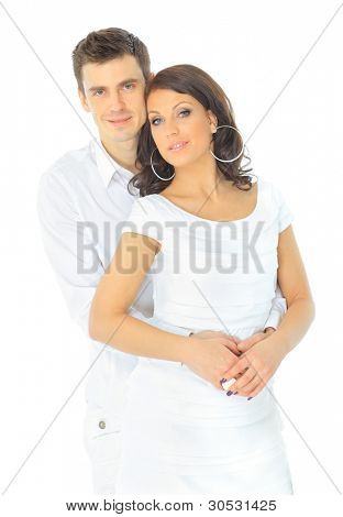Portrait of a romantic young couple standing together over white backgrou