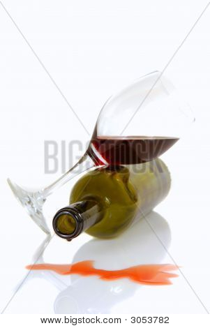 Wine Bottle And Glass Resting On Their Sides