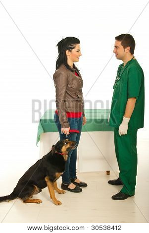 Owner With Dog Visiting Vet Doctor