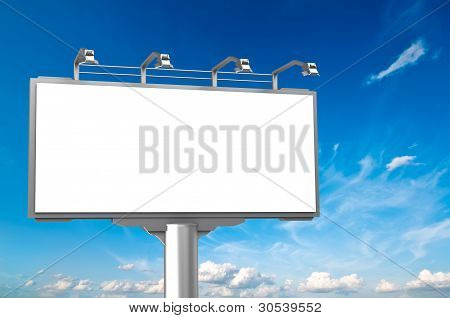 Empty advertisement hoarding at sky background