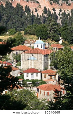 the old church of St. George in Fidakia, a village located in the mountains covered with pine of the Evritania - Greece