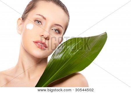 woman portrait with green leaf