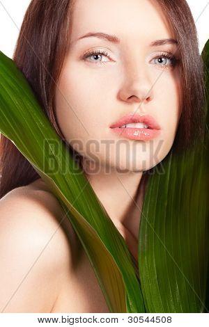 woman portrait with green leaf