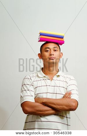 Ethnic Male College Student With Books On Head