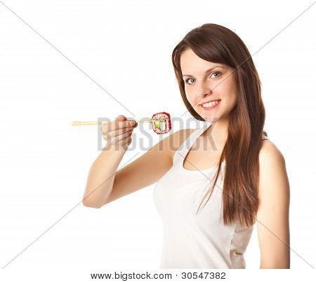 Young woman is eating sushi