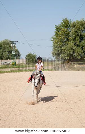 Little Girl Taking Horseback Riding Lessons