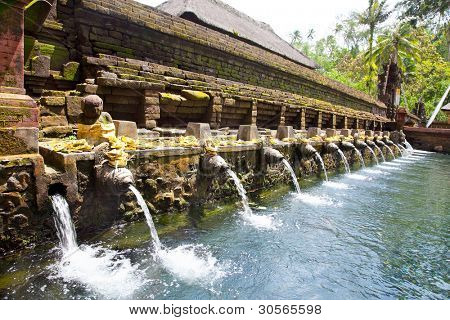 Holy spring water in temple pura Tirtha Empul inTampak, one of  Bali's most important temples, Indonesia