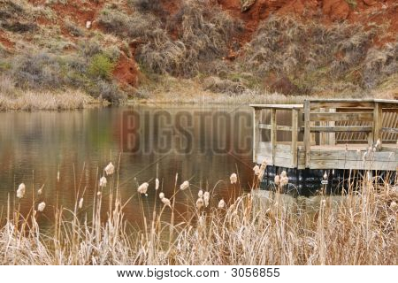 Public Fishing Lake With Wooden Dock