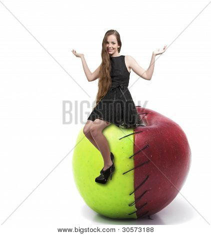 Teenage Woman On Sweet And Sour Apple