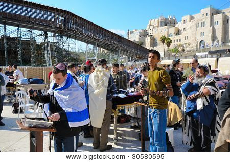 JERUSALEM - FEBRUARY 20: Jews pray at the Kotel (Western Wall) February 20, 2012 in Jerusalem, IL. The kotel is one of the holiest sites in Judaism attracting thousands of worshipers daily.