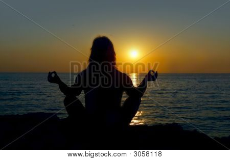 Woman Silhouette Making Yoga