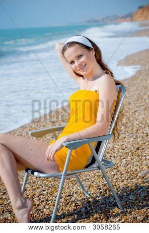Beautiful Girl Relaxing At Beach