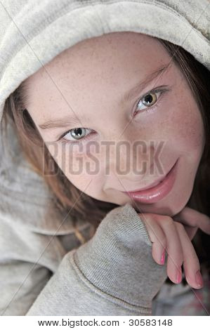 Young girl in hoodie with pretty face