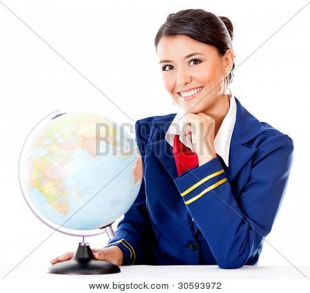 Flight attendant with the globe choosing the next destination - isolated over white