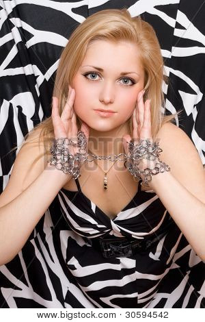 Blonde Stretches Out Her Hands In Chains