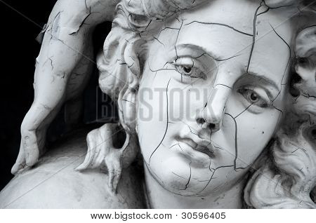Cracked face of greek sculpture