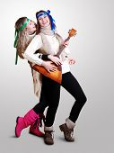 foto of mummer  - Two laughing beautiful girls dancing and plaing on balalaika - JPG