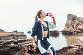Drink More Water. Sporty Young Woman In Sportswear Drinking Water After Workout While Sitting On The poster