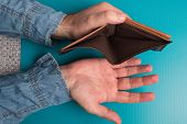 Empty Mens Wallet Studio Image. Mens Hands Holding An Empty Leather Wallet. poster