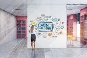 Blonde Woman Drawing Colorful Web Design Sketch On White Office Wall. Concept Of Hi Tech In Business poster