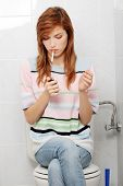 foto of teen smoking  - Teen girl caught on smoking in bathroom - JPG