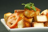 stock photo of paneer  - cooked indian paneer cheese and tomato on a grey background - JPG
