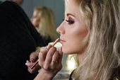 Make-up Artist Working In A Make-up Studio, Applying Makeup On The Face Of Female Clients. Makeup Ar poster