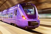 picture of railroad car  - Modern high speed train with motion blur effect at the railway station - JPG