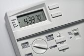 stock photo of air conditioner  - Programmable digital thermostat on a white wall - JPG