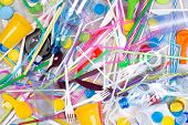 Disposable single use plastic objects such as bottles, cups, forks, spoons and drinking straws that  poster