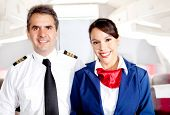 picture of cabin crew  - Airplane cabin crew with pilot and flight attendant smiling - JPG