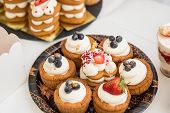 Various Mini Cakes. Sweets Decorated With Fresh Berries For Holiday.tasty Cake.small Cakes With Vari poster